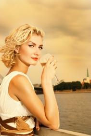 bigstock-Beautiful-blond-girl-drinks-ch-13194626